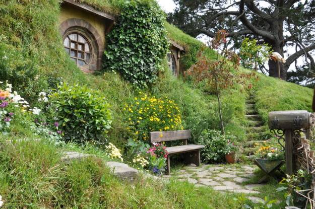 An image of flower gardens out front of Bilboo Baggins Home at Hobbiton in New Zealand. Photography by Frame To Frame - Bob and Jean.