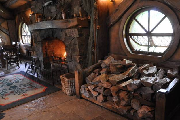 An image of the main fireplace inside the Green Dragon Pub at Hobbiton in New Zealand. Photography by Frame To Frame - Bob and Jean.