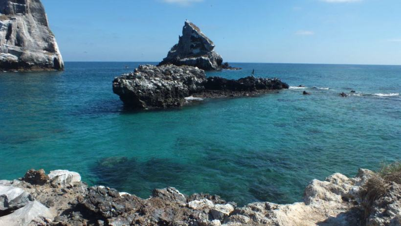 An image of the rocky shoreline along Isla Isabel off San Blas, Mexico. Photography by Frame To Frame - Bob and Jean.