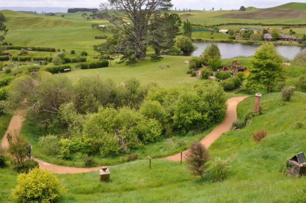 A wide angle image of the party field and distant hills at Hobbiton in Matamata, New Zealand. Photography by Frame To Frame - Bob and Jean