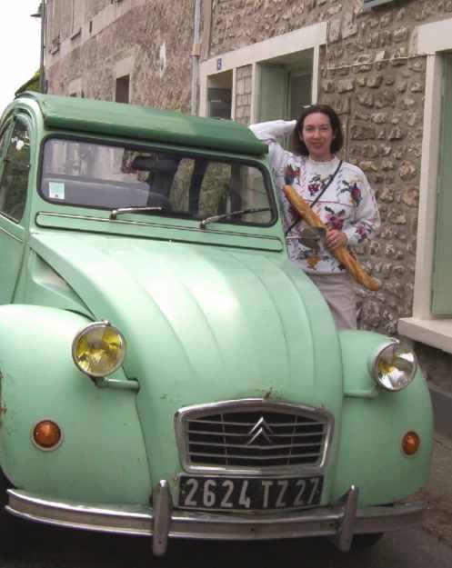 An image of Jean beside a vintage car in Giverny, France.