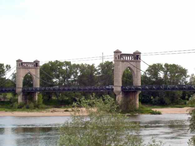 An image of the multi-span suspension bridge across the Loire River in the town of Langeais in France.