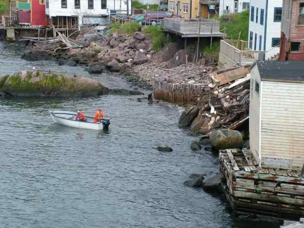 an image of workmen clearing debris from the storm surge of 2010 in St. John's, Newfoundland, Canada