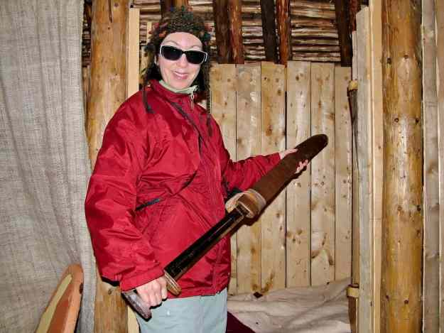 jean unsheaths a viking sword at l'anse aux meadows, newfoundland, canada