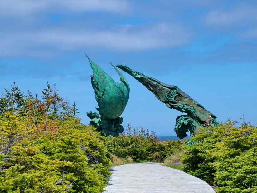 the meeting of two worlds sculpture at l'anse aux meadows, newfoundland, canada