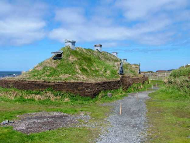 a re-created longhouse at l'anse aux meadows, newfoundland, canada