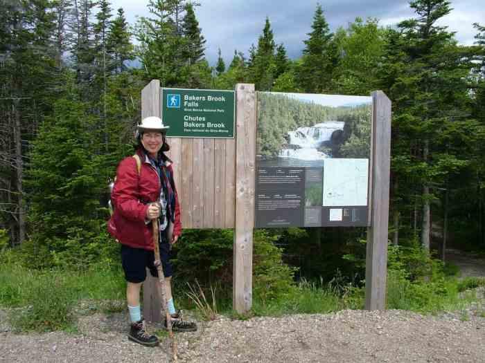 Jean at Baker's Brook Falls sign in Gros Morne National Park, Newfoundland
