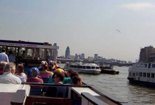 An image of a tour boat on the Thames River in London, England.
