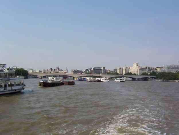 An image of boats on the Thames River in London, England.