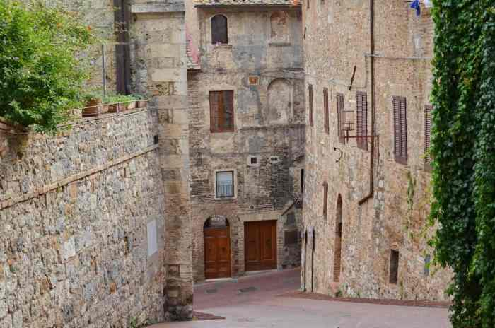 Image of the stone walls and buildings inside San Gimignano, Italy.
