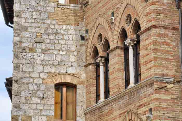 Image of gothic arches on one of the building's in San Gimignano, Italy.