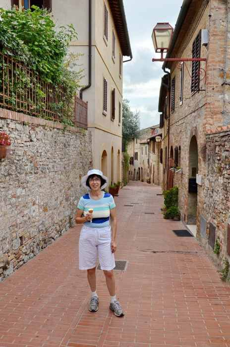 Image of time out for a delicious gelatto in San Gimignano, Italy.