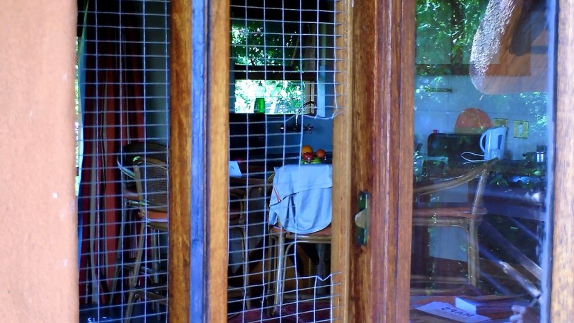 windows with chicken wire at hilltop camp, hluhluwe-imfolozi, south africa