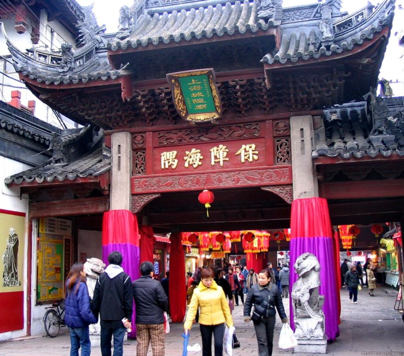 People entering the main street gate to the City God Temple of Shanghai, in Shanghai, China.