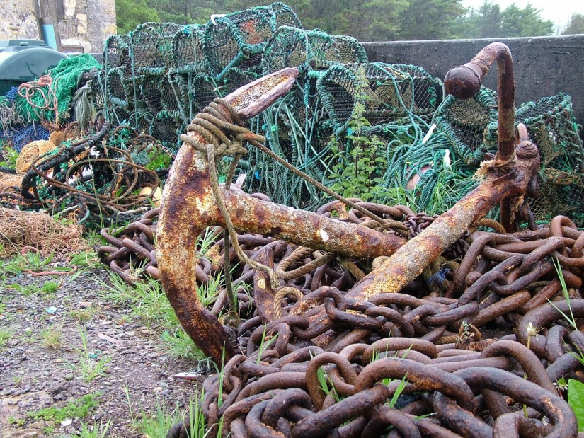 a rusty anchor and chains and lobster traps, ballinskelligs, ireland