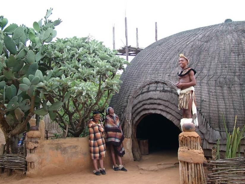 a zulu warrior sharing a laugh, shakaland, kwazulu-natal, south africa