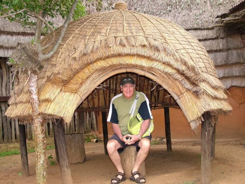 bob under a thatched shelter, shakaland, kwazulu-natal, south africa