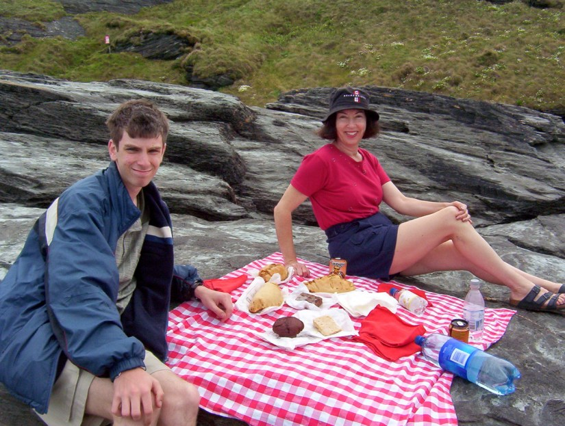 jean and her son picnicking at trebarwith strand beach, cornwall, england