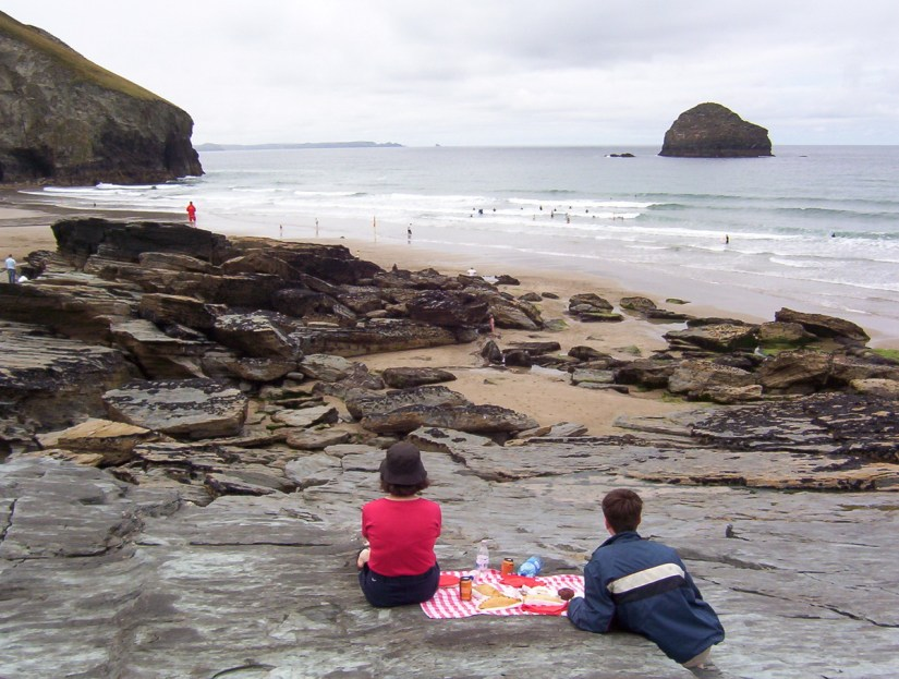 picnickers at trebarwith strand beach, cornwall, england