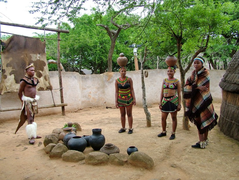zulu maidens carrying clay pots on their heads, shakaland, kwazulu-natal, south africa