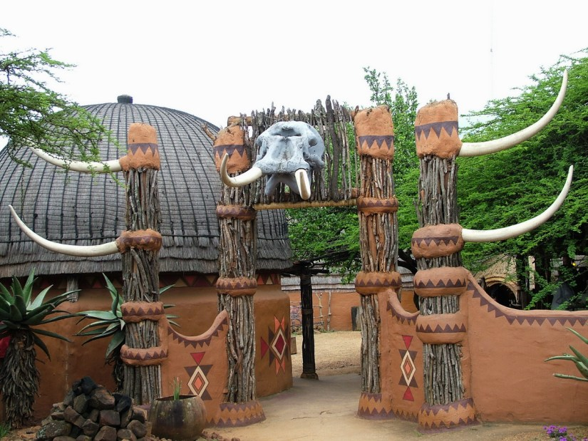 a portal crowned with an elephant's skull, shakaland, kwazulu-natal, south africa