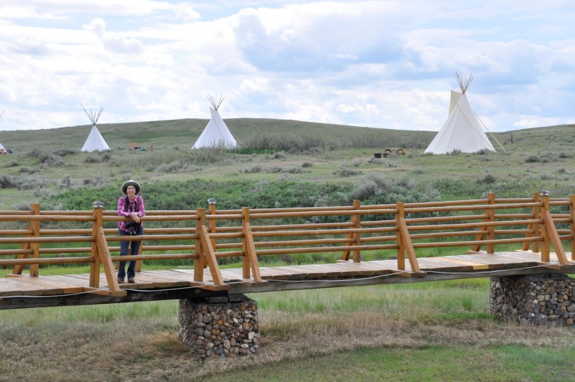 jean on the bridge at rock creek campground, grasslands national park east block, saskatchewan