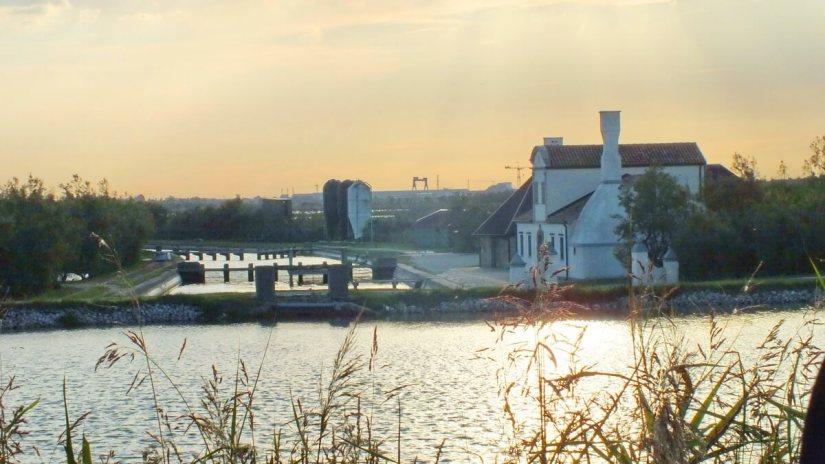 control gates of a canal, parco regionale veneto del delta del po, po river delta, italy