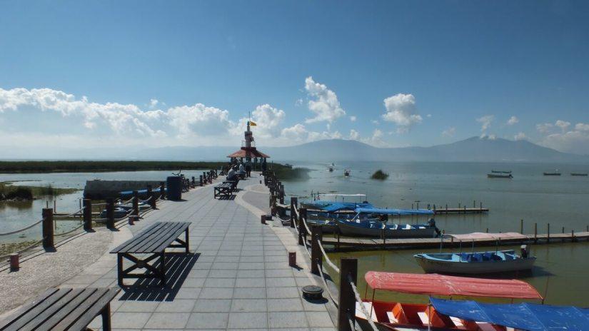 tour boats along a pier, lake chapala, mexico