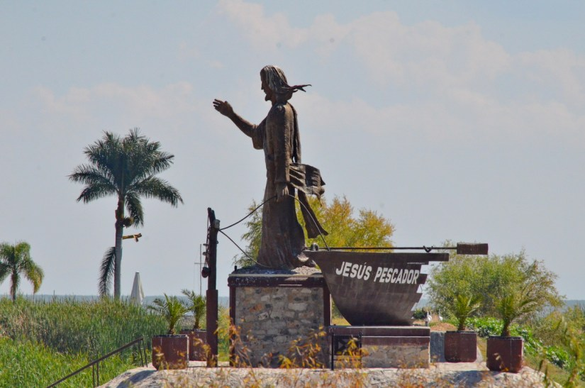 statue of jesus blessing the fishermen, lake chapala, mexico