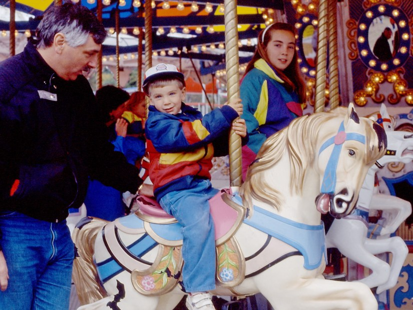 bob with his kids on the merry-go-round, markham fair, 1991
