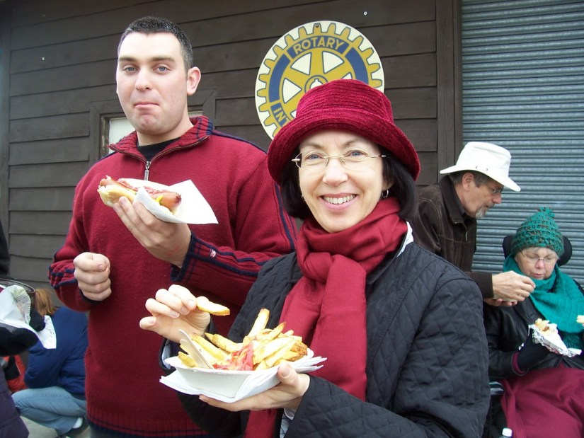people eating french fries and hot dogs, markham fair, markham, ontario, 2008