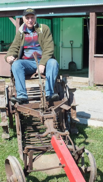 bob on antique farm equipment, markham fair, markham, ontario, 2012