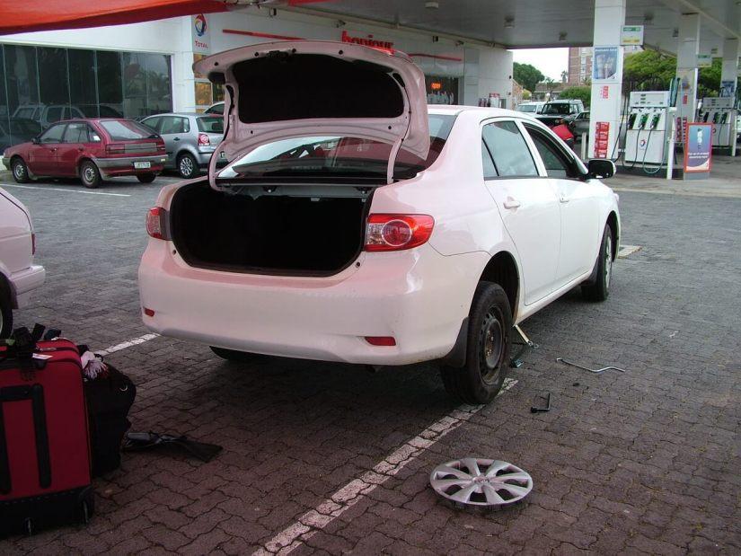 car with flat tire, port elizabeth, south africa