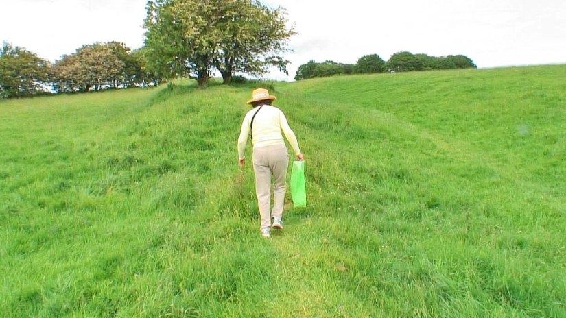 jean climbing hill to fairy tree of tara, county meath, ireland