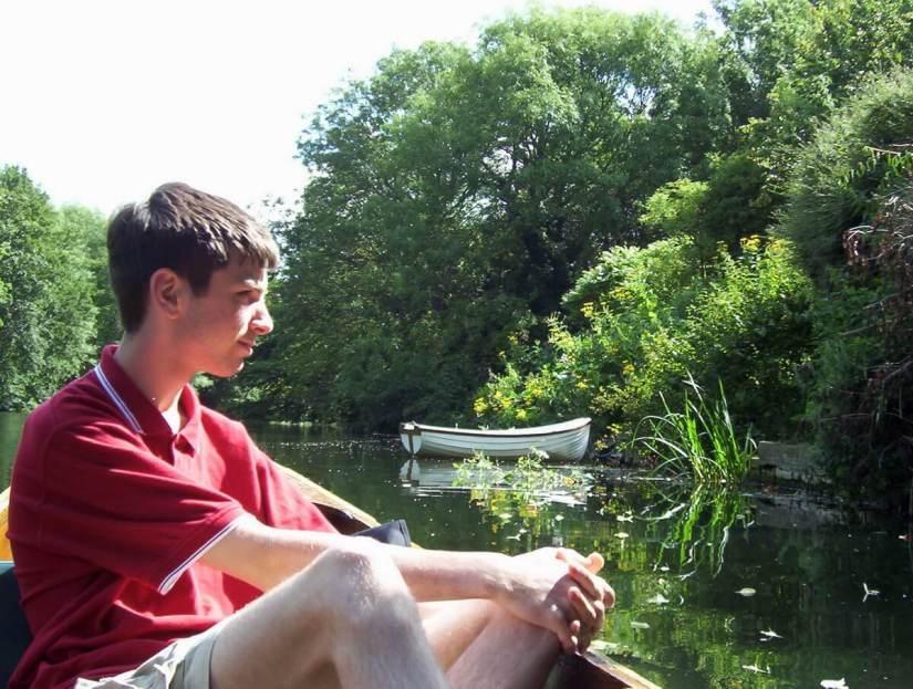 a person in a punt, avon river, bath, england