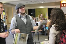 """""""Newsboy"""" Bob talks with students about the latest issue of the paper."""