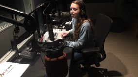 Anne DJing in the new 91.7 radio studio in the Learning Commons.