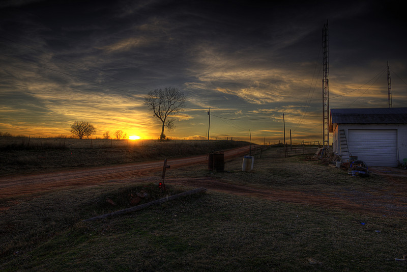 This image of a Midway Station, Oklahoma sunset was taken on a cold but sunny December evening, deep in the Oklahoma countryside, close to the town of Mulhall. We were visiting relatives who live at Midway Station, a one time small holding/grocery store/automobile shop (or garage for my UK readers) that was operated by Lorne and Alice Stewart through the mid to late 1900's. In its day the station played an important focal point in a very rural community but now is a quiet residential property. - See more at www.thesunrideshigh.com
