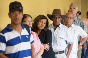 DOMINICAN REPUBLIC, Santo Domingo : People wait in line to vote at a polling station during general elections in Santo Domingo on May 15, 2016. Voting began Sunday in the Dominican Republic's presidential election, where incumbent leader Danilo Medina is tipped to win despite grinding poverty and widespread crime. / AFP PHOTO / Fran Afonso