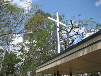 (White cross at Inala)