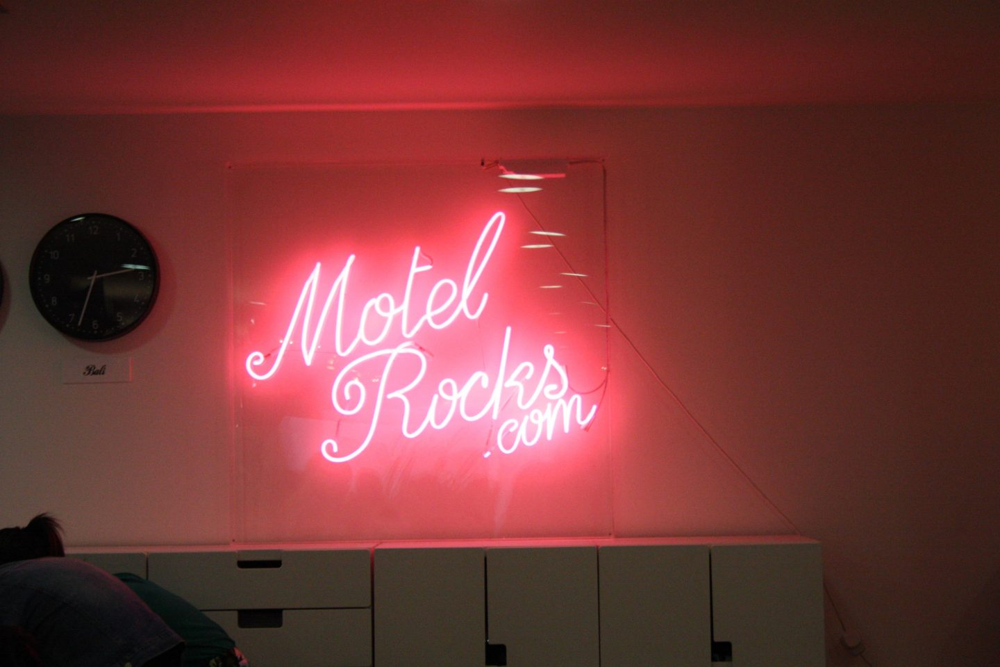 the motel rocks logo in neon at their launch event