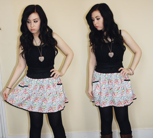 blogger francesca sophia wearing a black lace vest top, a multi coloured alice mccall skirt, black tights, and brown boots