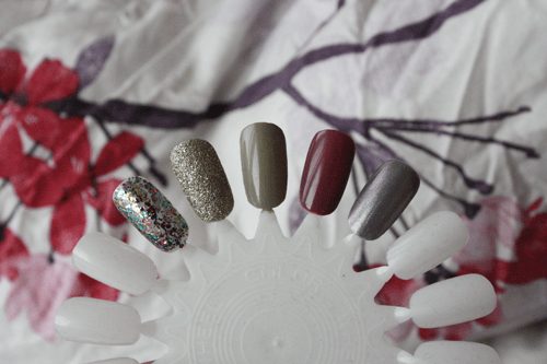 five favourite autumn (fall) winter transition nail polishes; swatches of Models Own 'Ibiza Mix'; Barry M 'Majesty'; Models Own 'Concrete Mixer'; Essie 'Island Hopping'; Revlon 'Smouldering'.