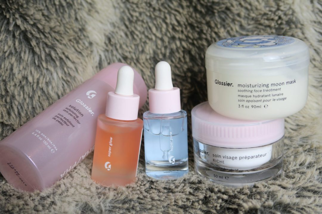 glossier solution, glossier super glow, glossier super pure, glossier priming moisturiser rich, glossier moisturising moon mask, all on a grey fur throw, on francescasophia.co.uk