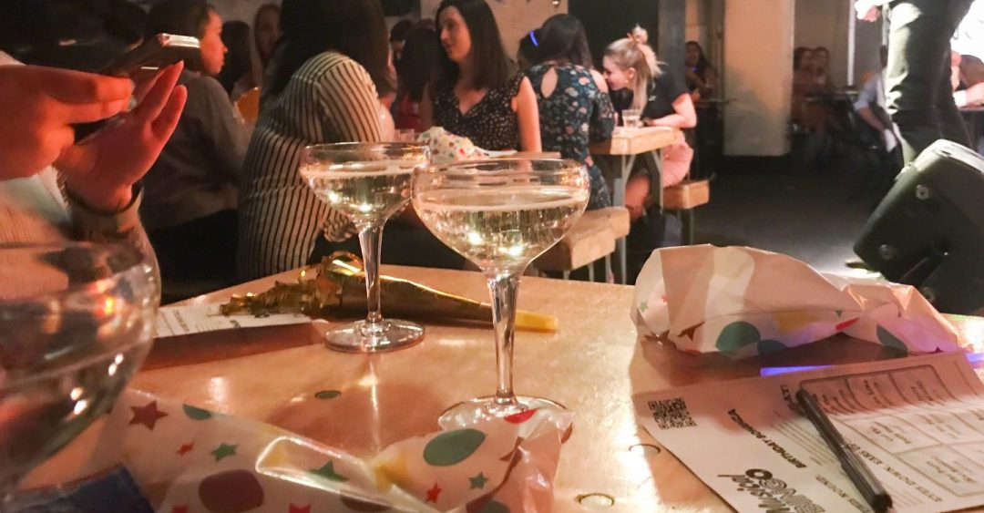 two flutes of champagne sit on a table for Musical Bingo London Shoreditch Review on francescasophia.co.uk