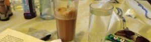 frappe and water on table