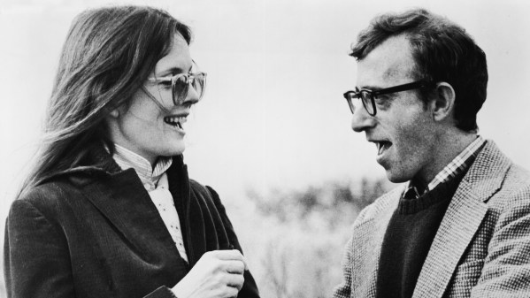 American actress Diane Keaton and American film director and actor Woody Allen talk in still from the film 'Annie Hall,' written and directed by Allen, 1977. (Photo by United Artists/Courtesy of Getty Images)