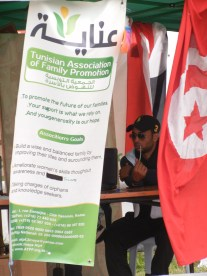 """A state organization nestled among the anarchists and focused on """"family promotion""""; 30 March 2013; Manar University; WSF, Tunis; photo by Frances Hasso"""