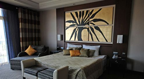 Art   Wall D    cor   The Great Frame Up    Chicago Photo of beautifully decorated hotel bedroom with four piece custom framed  artwork on the wall