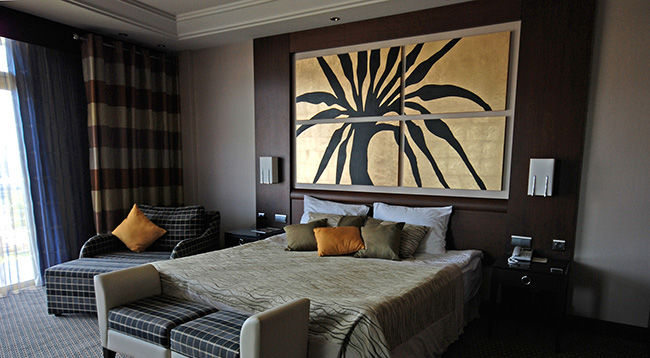 Art   Wall D    cor   The Great Frame Up    Pearland Photo of beautifully decorated hotel bedroom with four piece custom framed  artwork on the wall